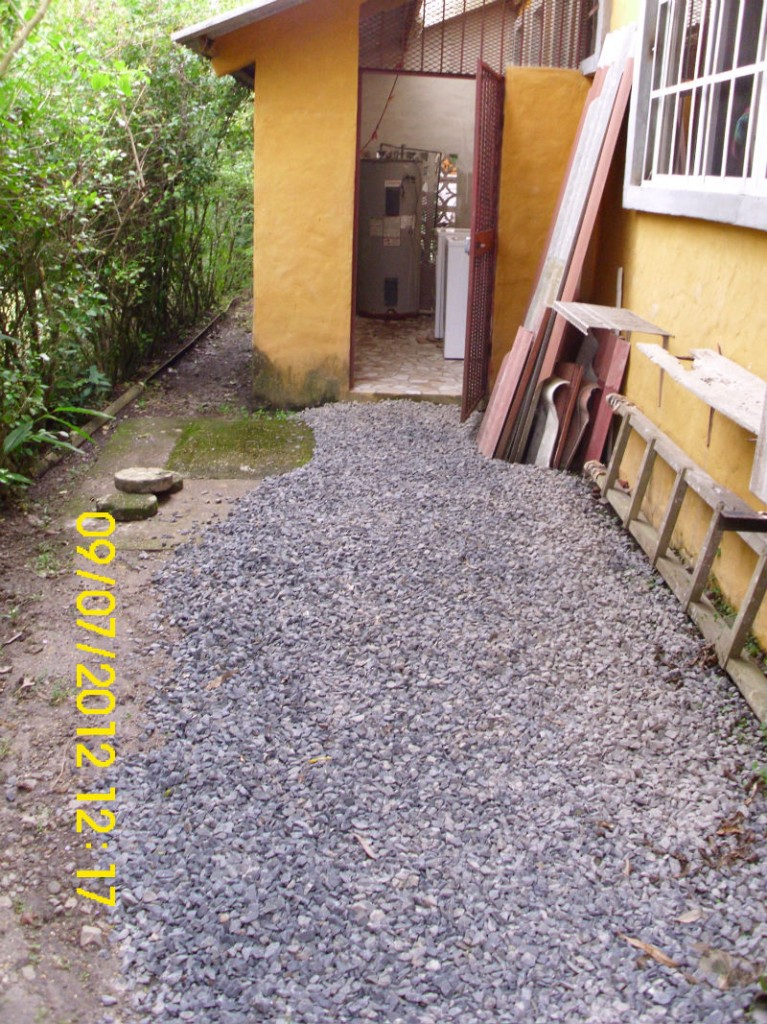 The Path To Laundry Room Behind House Comes With A Washer